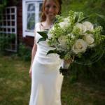 Den vackra bruden med sin bukett