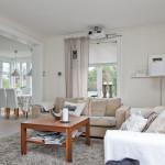 Skön ombonad vardagsrumsdel i anslutning till köket - interiör fotografering